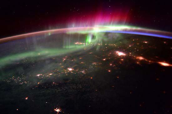 <div class='meta'><div class='origin-logo' data-origin='none'></div><span class='caption-text' data-credit='@StationCDRKelly/ NASA'>The Aurora Borealis and the Pacific Northwest</span></div>