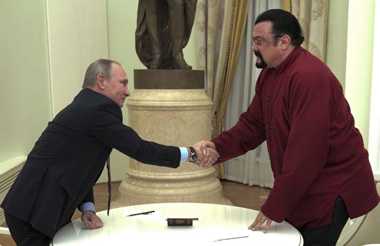 <div class='meta'><div class='origin-logo' data-origin='none'></div><span class='caption-text' data-credit='(Alexei Druzhinin/Sputnik, Kremlin Pool Photo via AP)'>Putin has given a Russian passport to Seagal, a regular visitor to Russia in recent years, calling it a sign of a thaw in relations between the two countries.</span></div>
