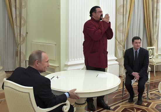 <div class='meta'><div class='origin-logo' data-origin='none'></div><span class='caption-text' data-credit='(Alexei Druzhinin/Sputnik, Kremlin Pool Photo via AP)'>Russian President Vladimir Putin, left, hosts U.S. actor Steven Seagal in the Kremlin in Moscow, Friday, Nov. 25, 2016.</span></div>