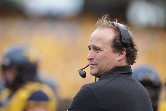 "<div class=""meta image-caption""><div class=""origin-logo origin-image ap""><span>AP</span></div><span class=""caption-text"">FILE - In this Sept. 26, 2015, file photo, West Virginia coach Dana Holgorsen watches his team play Maryland in an NCAA college football game in Morgantown, W.Va. . ((AP Photo/Raymond Thompson, File))</span></div>"