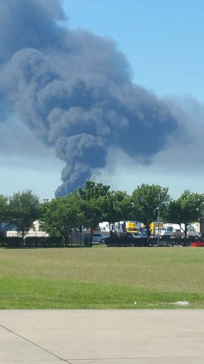 <div class='meta'><div class='origin-logo' data-origin='none'></div><span class='caption-text' data-credit=''>A massive fire is burning at an industrial complex in Spring Branch.</span></div>