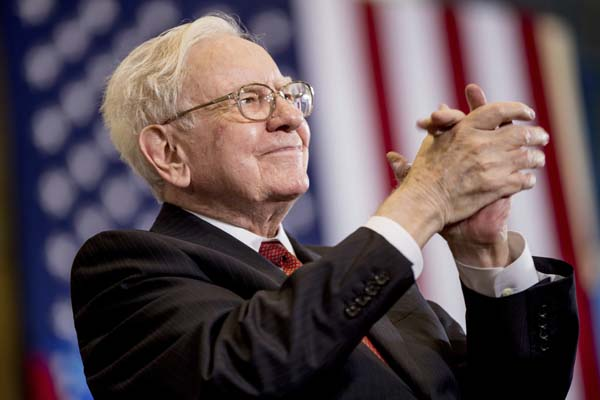 "<div class=""meta image-caption""><div class=""origin-logo origin-image none""><span>none</span></div><span class=""caption-text"">Berkshire Hathaway Chairman and CEO Warren Buffett applauds at a rally for Democratic presidential candidate Hillary Clinton in Omaha, Neb. (AP Photo/Andrew Harnik, file) (AP)</span></div>"