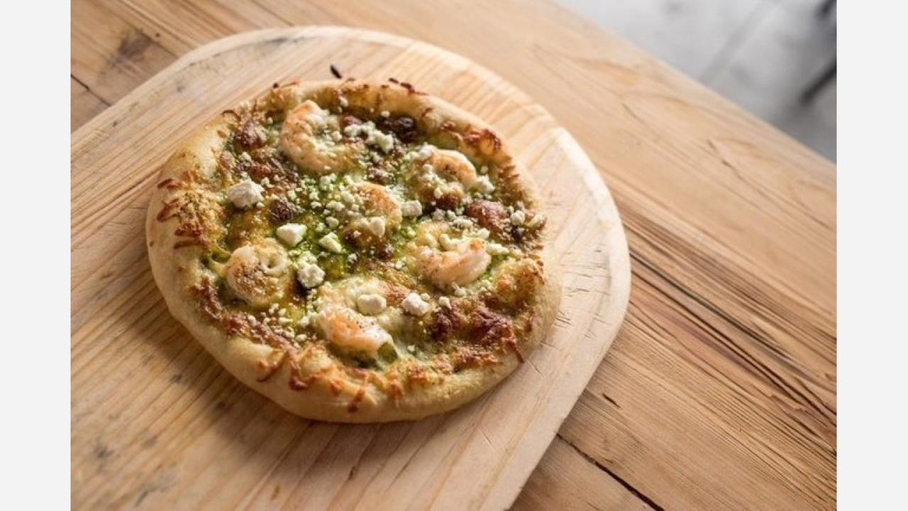 Shrimp and pesto pizza. | Photo: BirdDog Saint/Yelp