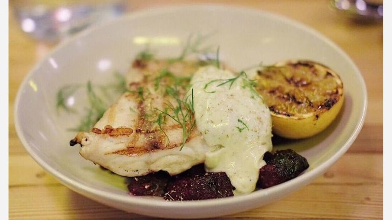 Roasted snapper at Nancys Hustle | Photo: Rob S./Yelp