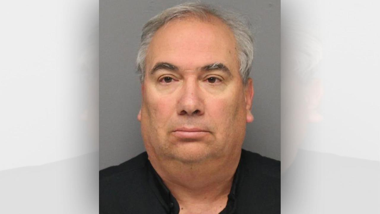 Priest accused of pointing gun at 8-year-old
