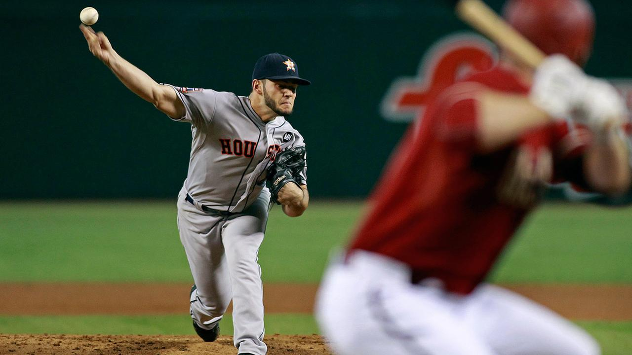Houston Astros starting pitcher Lance McCullers, left, throws against the Arizona Diamondbacks during the first inning