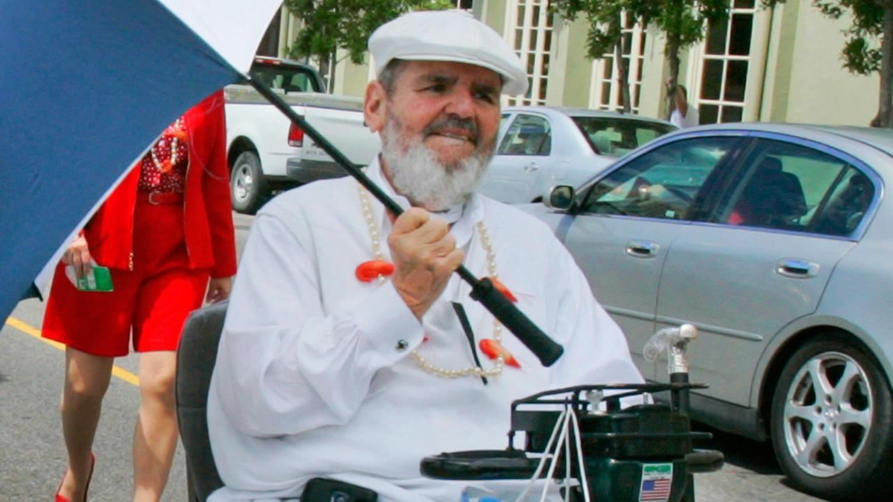 Chef Paul Prudhomme in 2008 leads a New Orleans jazz band through the historic French Quarter