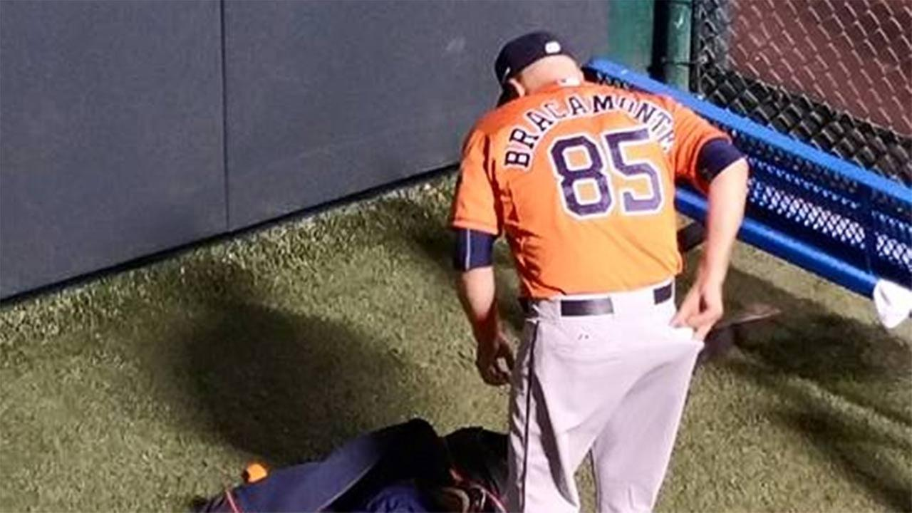 Houston Astros bullpen catcher Javier Bracamonte won over some Kansas City Royals fans with his actions after the game.