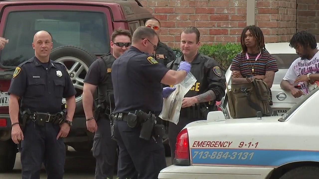 Police questioning person after shots were fired at officer in SE Houston