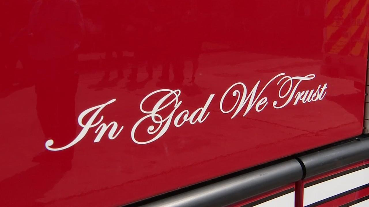 Baytown fire trucks, ambulances now feature 'In God we trust' stickers