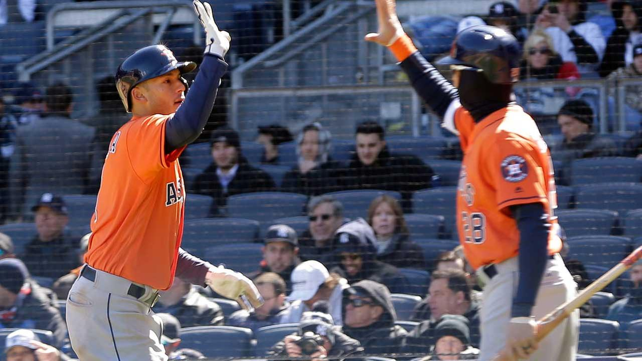Houston Astros Carlos Correa, left, is greeted by Colby Rasmus after he hit a solo home run