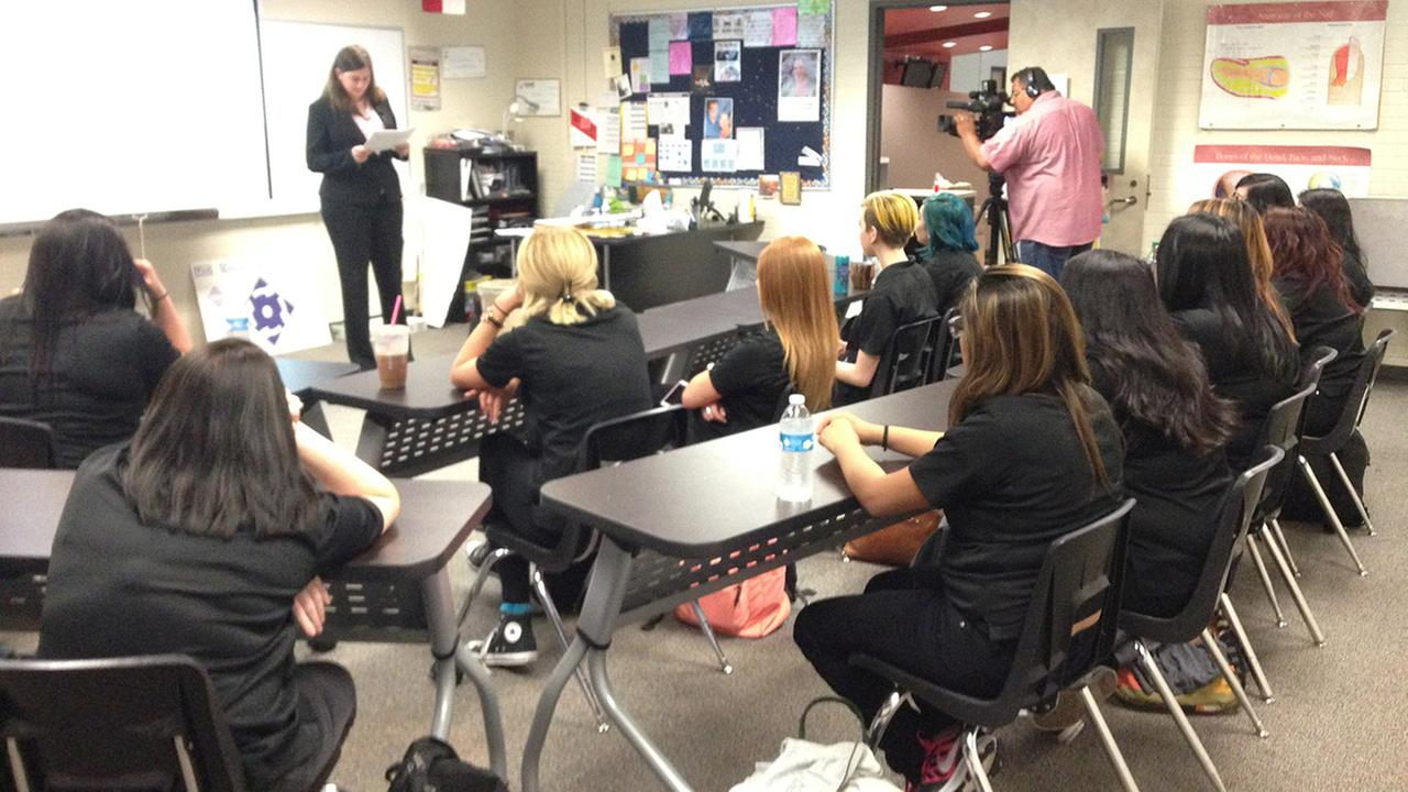 Cosmetology students learning to spot signs of domestic violence