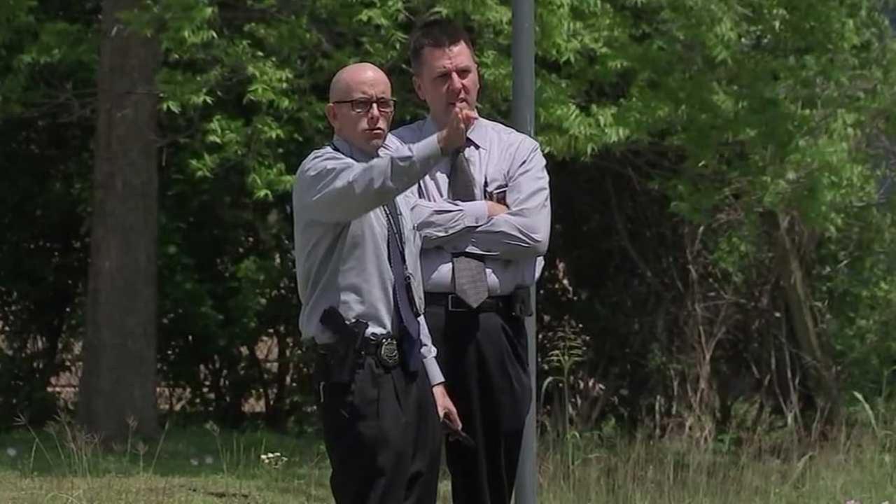 Investigators canvass the area where Deputy Alden Clopton was shot.