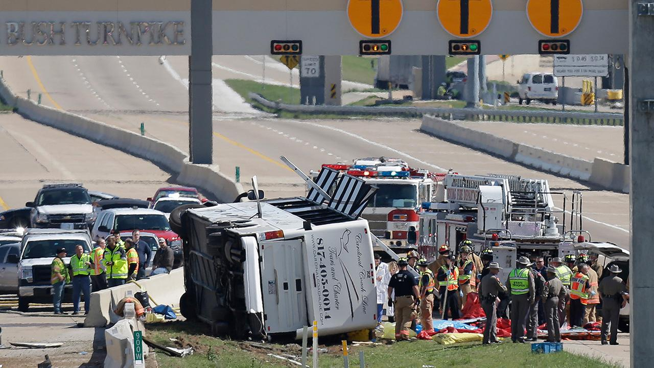 In this April 11, 2013 file photo, emergency responders works the scene of a bus crash on the George Bush Turnpike, in Irving, Texas.
