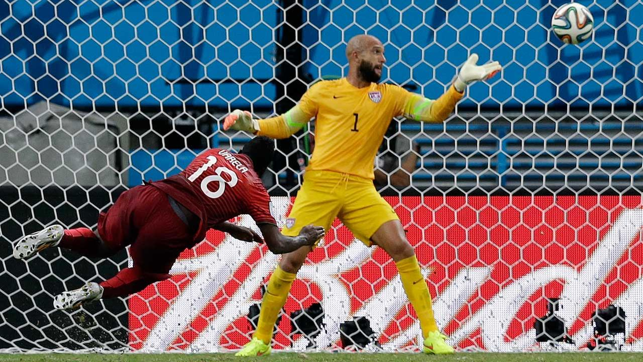 Portugals Silvestre Varela heads the ball past United States goalkeeper Tim Howard to score his sides second goal and tie the game 2-2, which would be the final (AP)