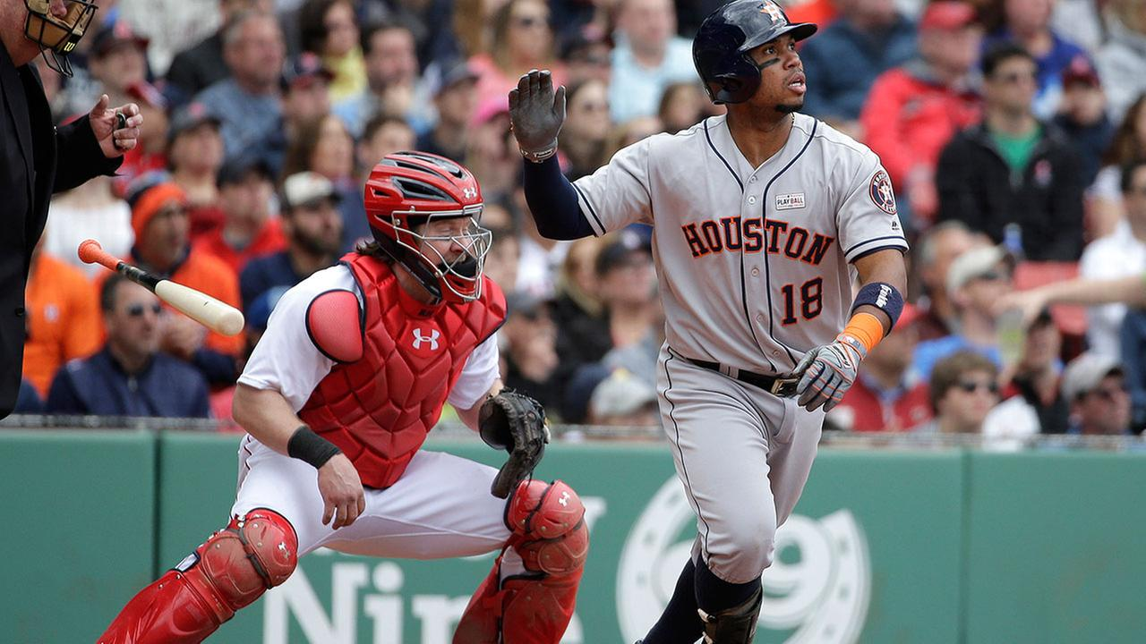 Houston Astros Luis Valbuena (18) tosses the bat while watching the flight of his ground rule double Sunday.