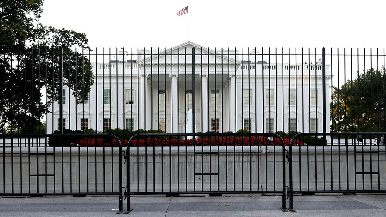 White House placed on lockdown after object thrown over gate