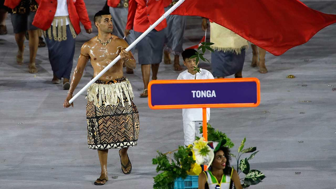 Pita Nikolas Aufatofua carries the flag of Tonga during the opening ceremony for the 2016 Summer Olympics in Rio de Janeiro, Brazil, Friday, Aug. 5, 2016.