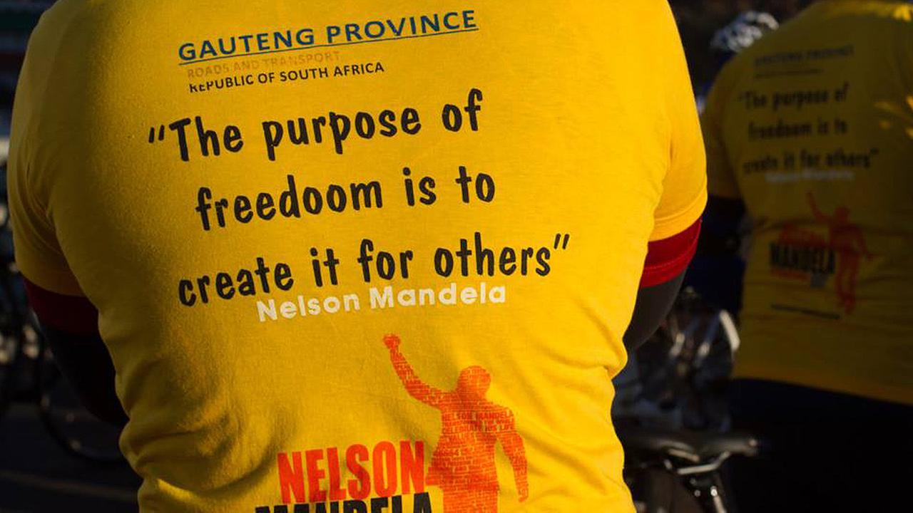 In this photo taken Sunday, July 20, 2014 a cyclist wears a t-shirt with a typographical error in the word freedom.