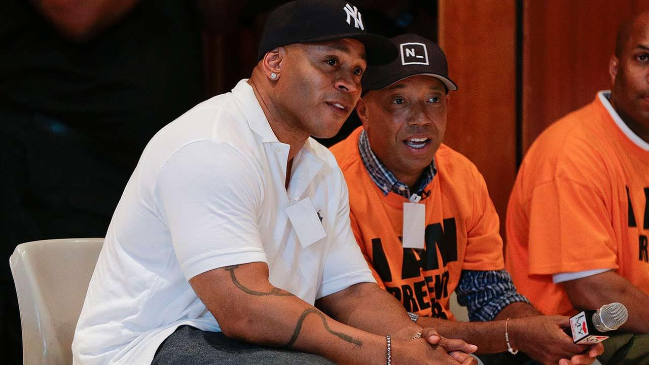Actor and music artist L.L. Cool J, left, talks with Def Jam co-founder Russell Simmons on a visit to speak with youth at the juvenile detention center of Rikers Island