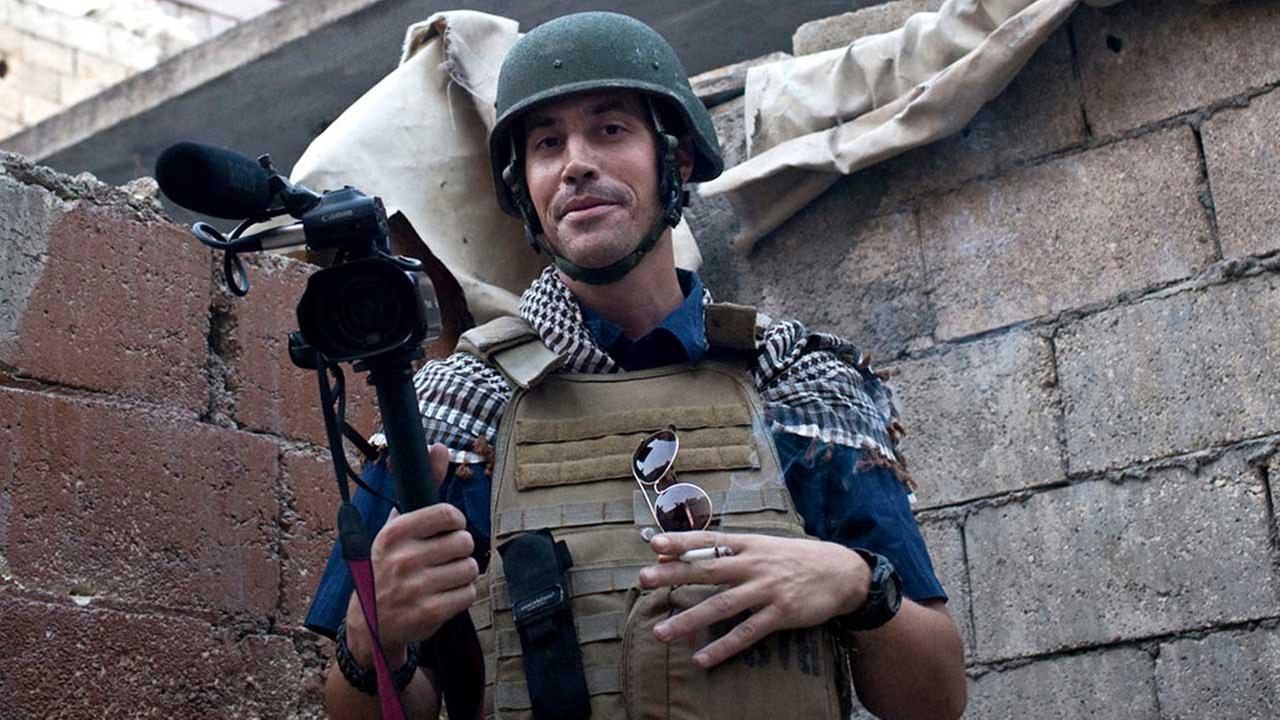 In this November 2012, file photo, posted on the website freejamesfoley.org, shows missing journalist James Foley while covering the civil war in Aleppo, Syria