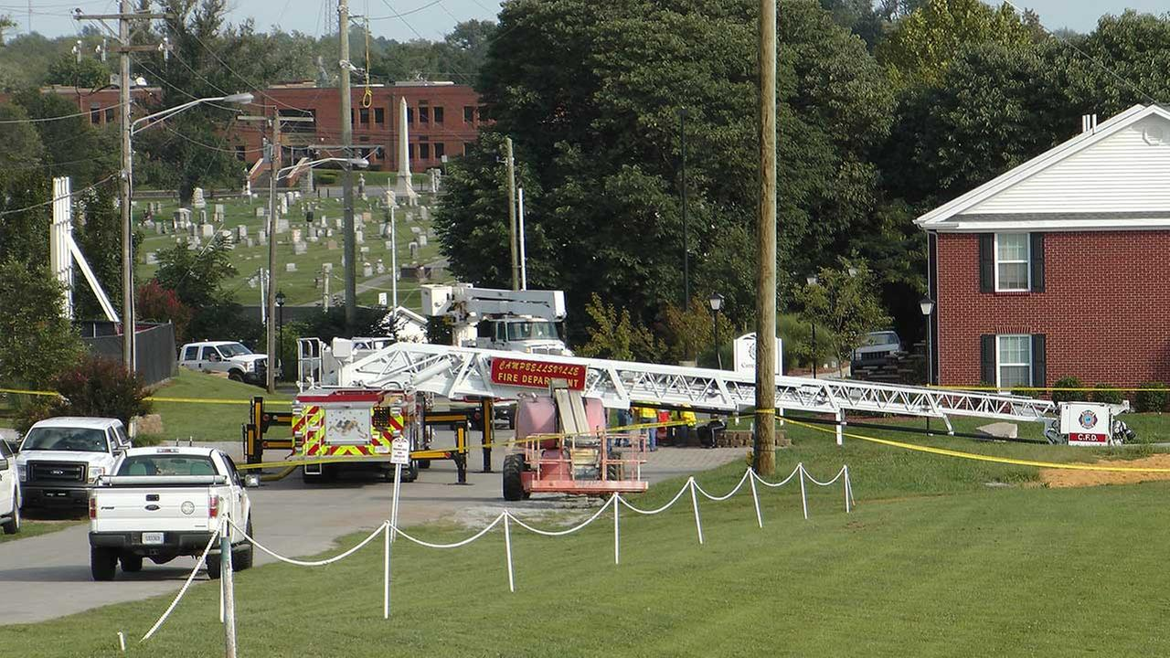 A Campbellsville Fire Department truck with the ladder extended remained at the scene where two firefighters were injured during an ice bucket challenge during a fundraiser for ALS