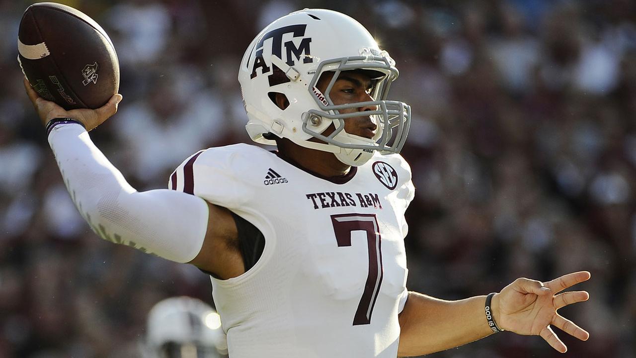 Texas A&M quarterback Kenny Hill (7) throws against South Carolina during the first half of an NCAA college football game on Thursday, Aug. 28, 2014, in Columbia, S.C. (AP)