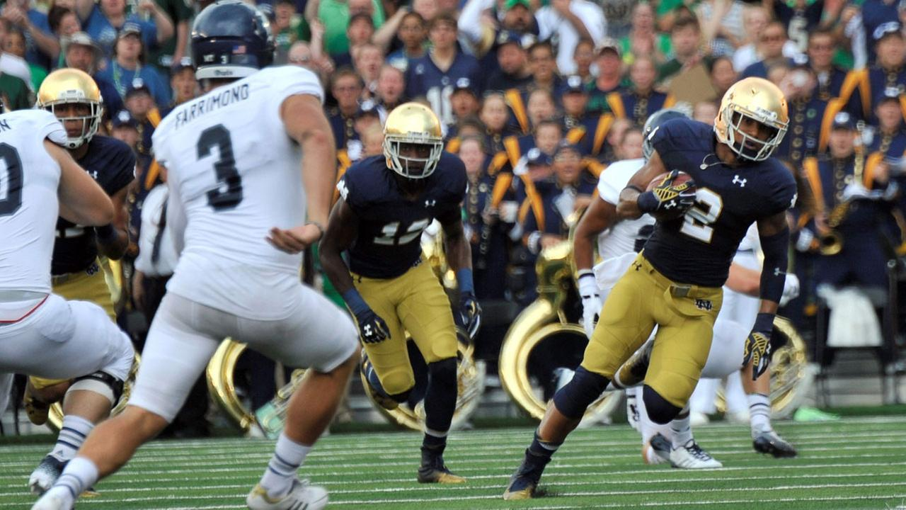Notre Dame returner Cody Riggs heads upfield during an NCAA college football game against Rice in South Bend, Ind., Saturday, Aug. 30, 2014. (AP Photo/Joe Raymond)