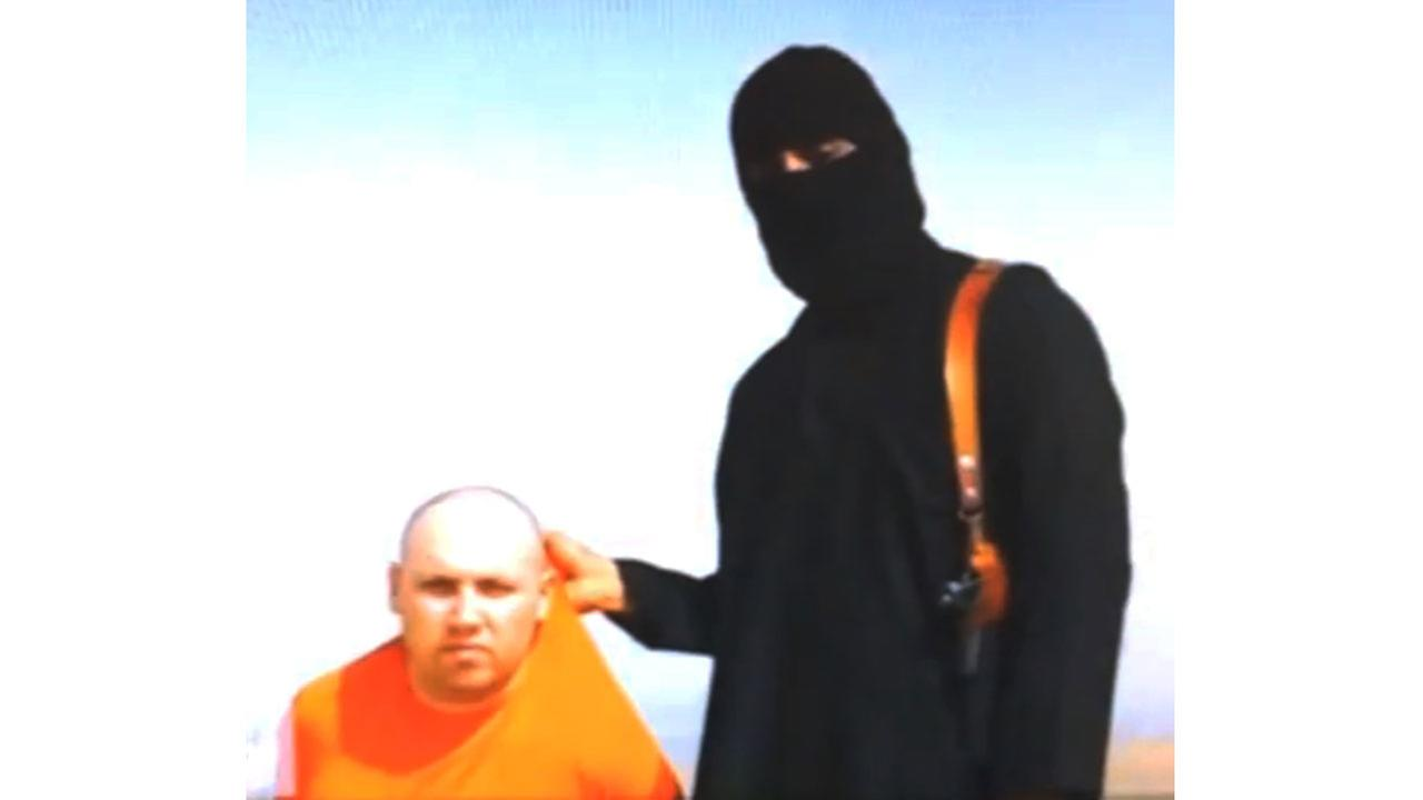 In this file image from an undated video released by Islamic State militants on Tuesday, Aug. 19, 2014, purports to show journalist Steven Sotloff being held by the militant (AP)