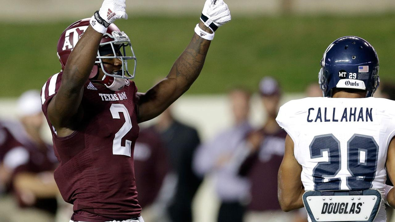 Texas A&M wide receiver Speedy Noil (2) celebrates his touchdown catch as Rice cornerback Bryce Callahan (29) walks past