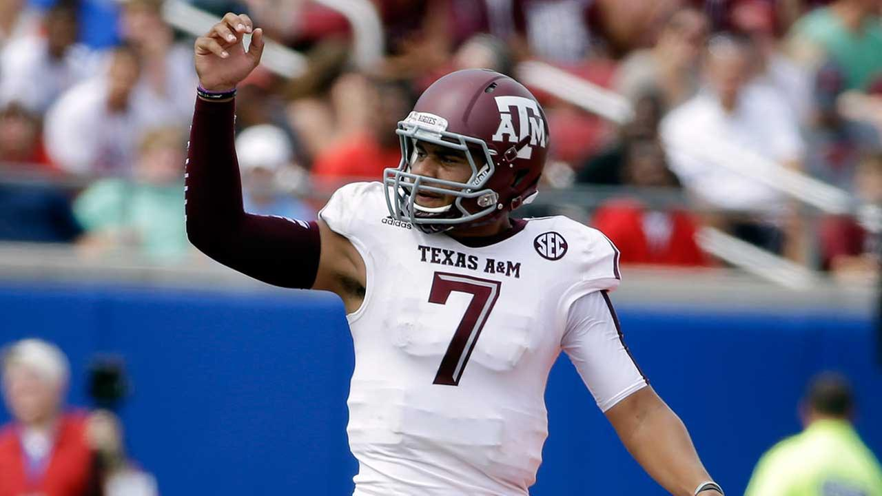 Texas A&M quarterback Kenny Hill celebrates a touchdown against SMU in the first half of an NCAA college football game, Saturday, Sept. 20, 2014, in Dallas.