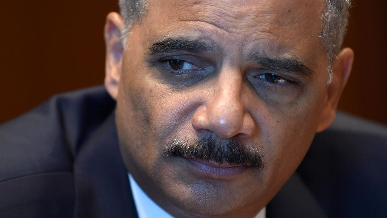 Attorney General Eric Holder speaks during an interview with The Associated Press at the Justice Department