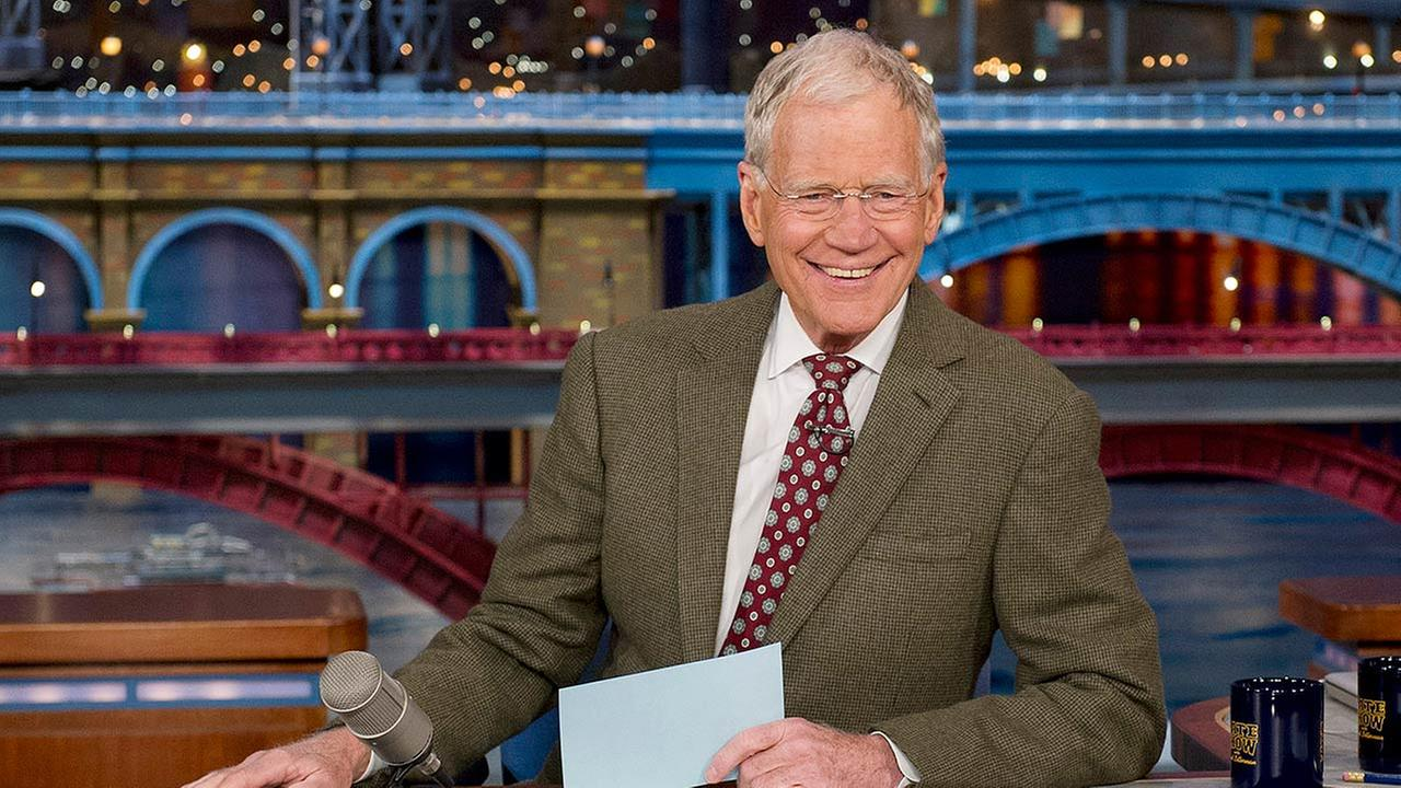 David Letterman, host of the Late Show with David Letterman, is seated at his desk in New York