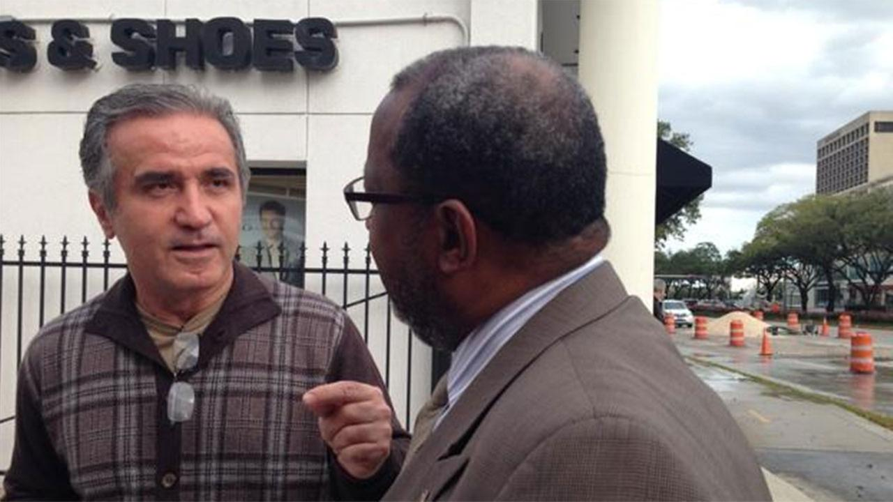 City officials chat with frustrated Galleria-area merchants after a water line ruptures in the area.
