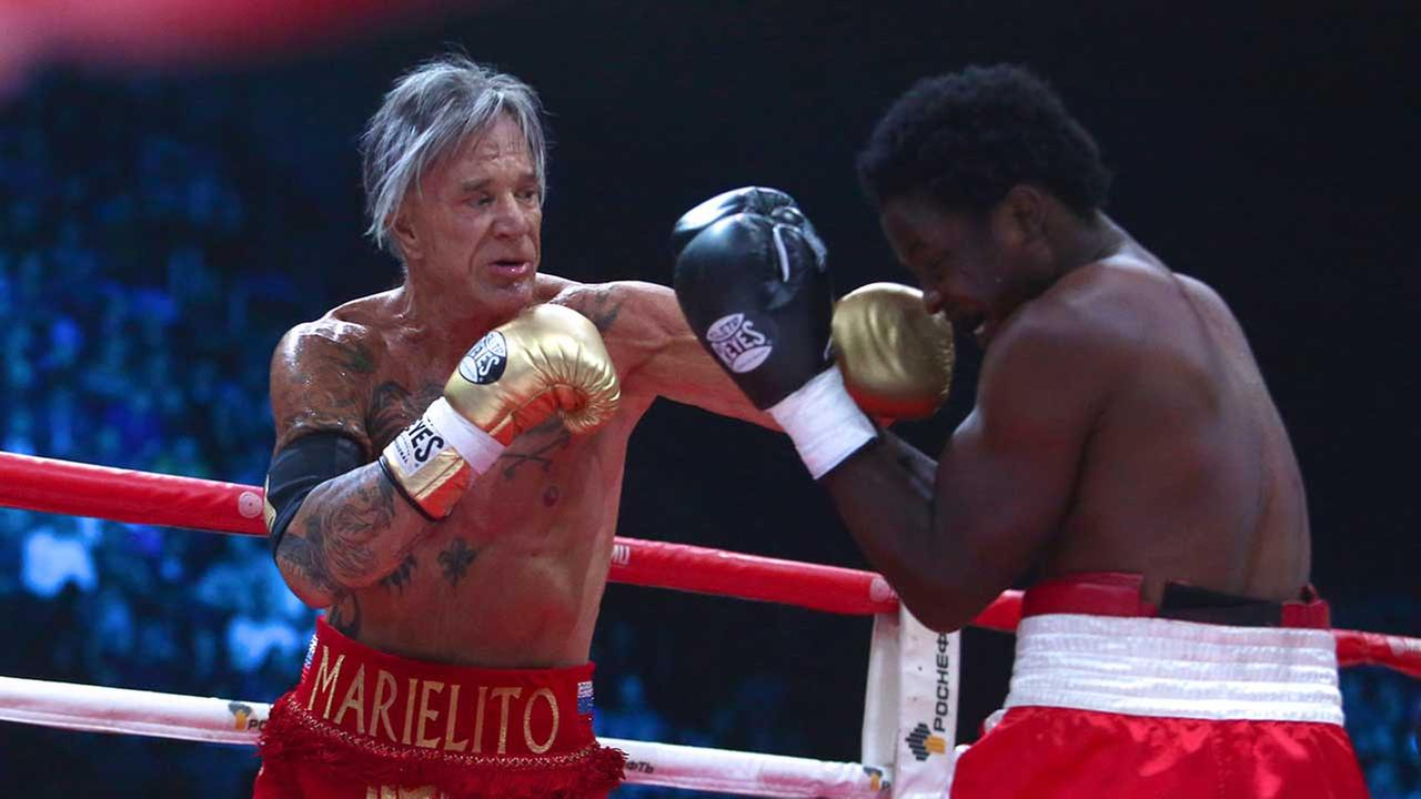 US actor Mickey Rourke, left, punches his opponent Elliot Seymour of the United States (AP)