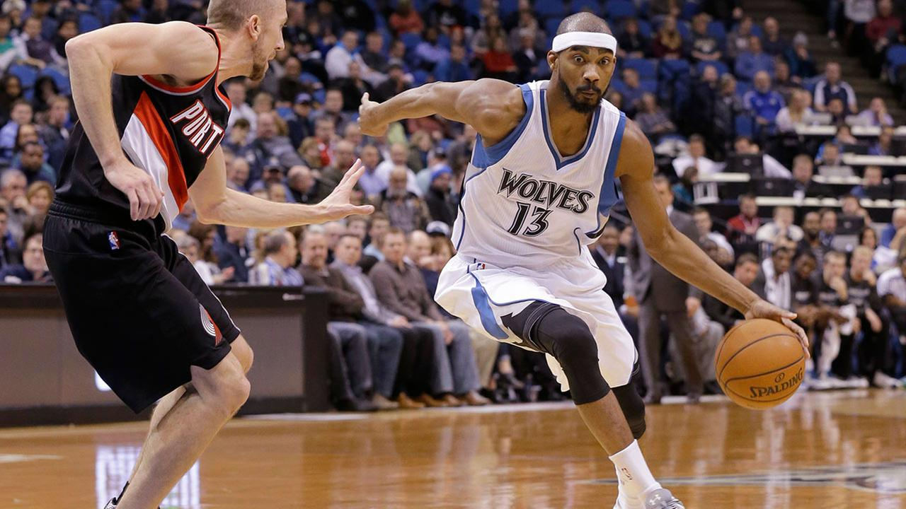 Minnesota Timberwolves guard Corey Brewer (13) drives against Portland Trail Blazers guard Steve Blake, left, during the fourth quarter of an NBA basketball game in Minneapolis