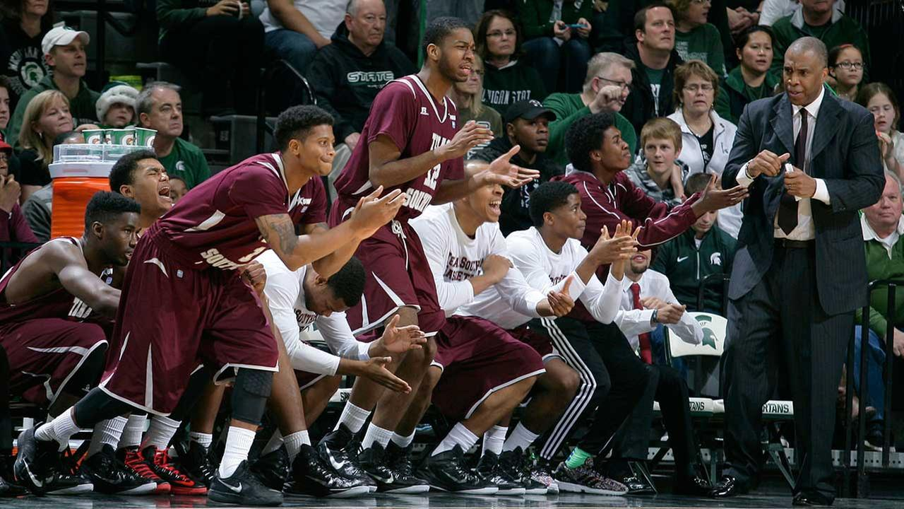 The Texas Southern bench, including head coach Mike Davis, right, celebrates during overtime against Michigan State