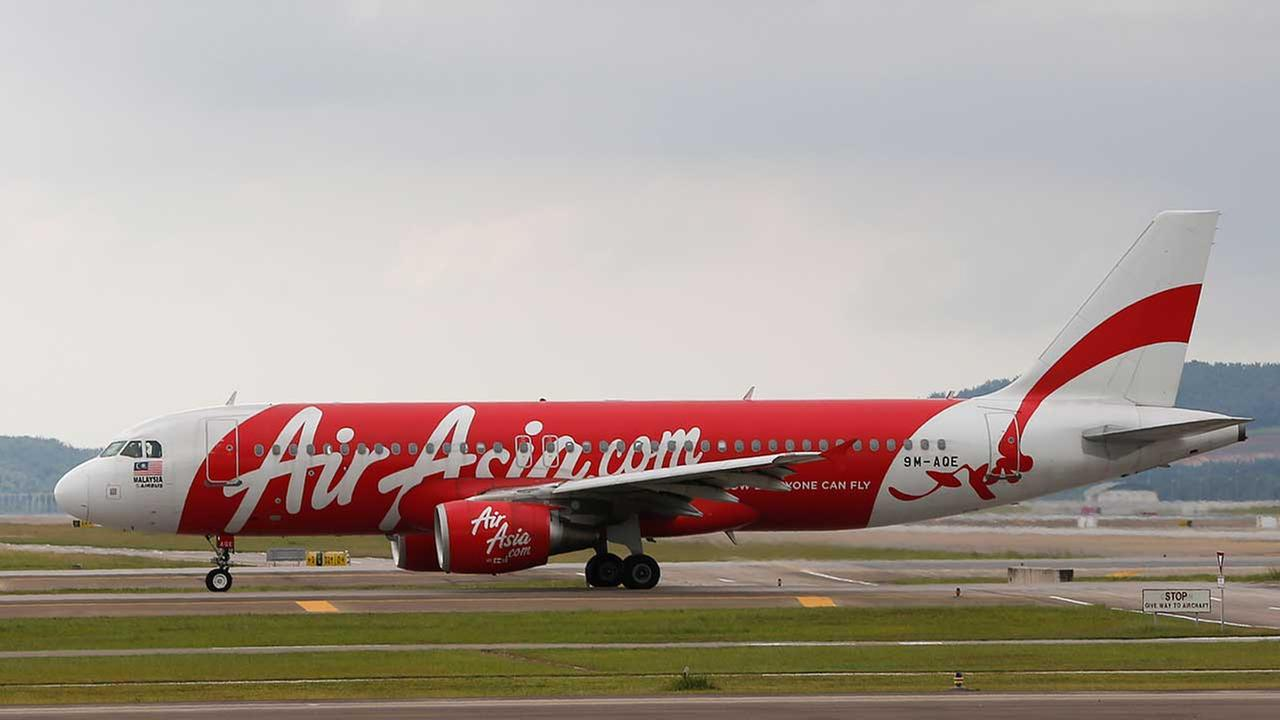 In this Nov. 26, 2014 photo, AirAsia Airbus A320-200 passenger jets are taxing on the tarmac at low cost terminal KLIA2 in Sepang, Malaysia
