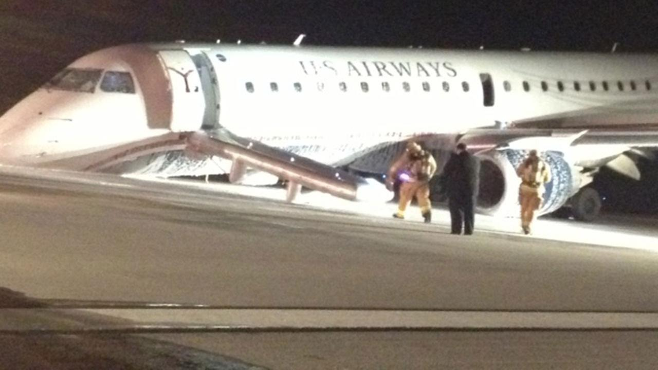 A U.S. Airways plane coming from Philadelphia Monday night was forced to make an emergency landing in Houston without its nose gear.