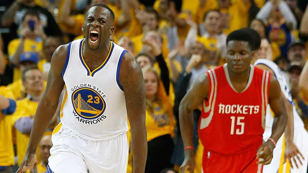 Golden State Warriors forward Draymond Green (23) reacts after scoring, in front of Houston Rockets center Clint Capela (15)