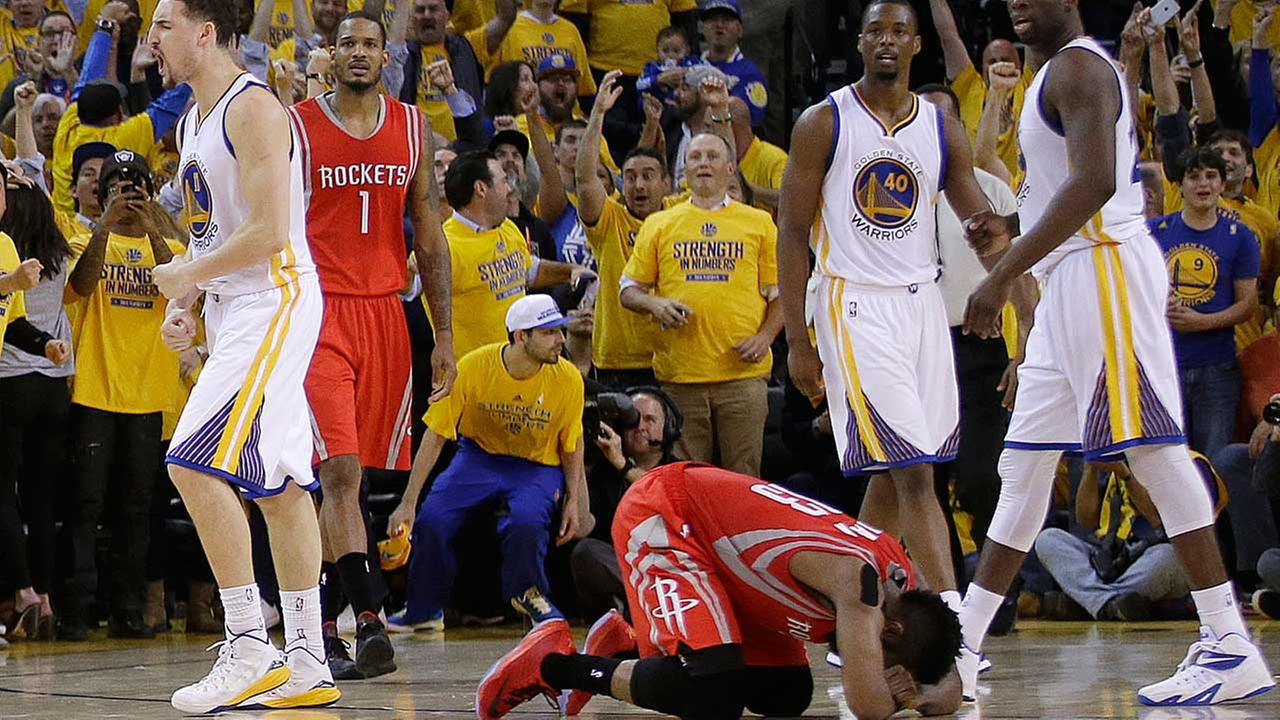 Houston Rockets guard James Harden, bottom, reacts after turning the ball over on the final play in Game 2