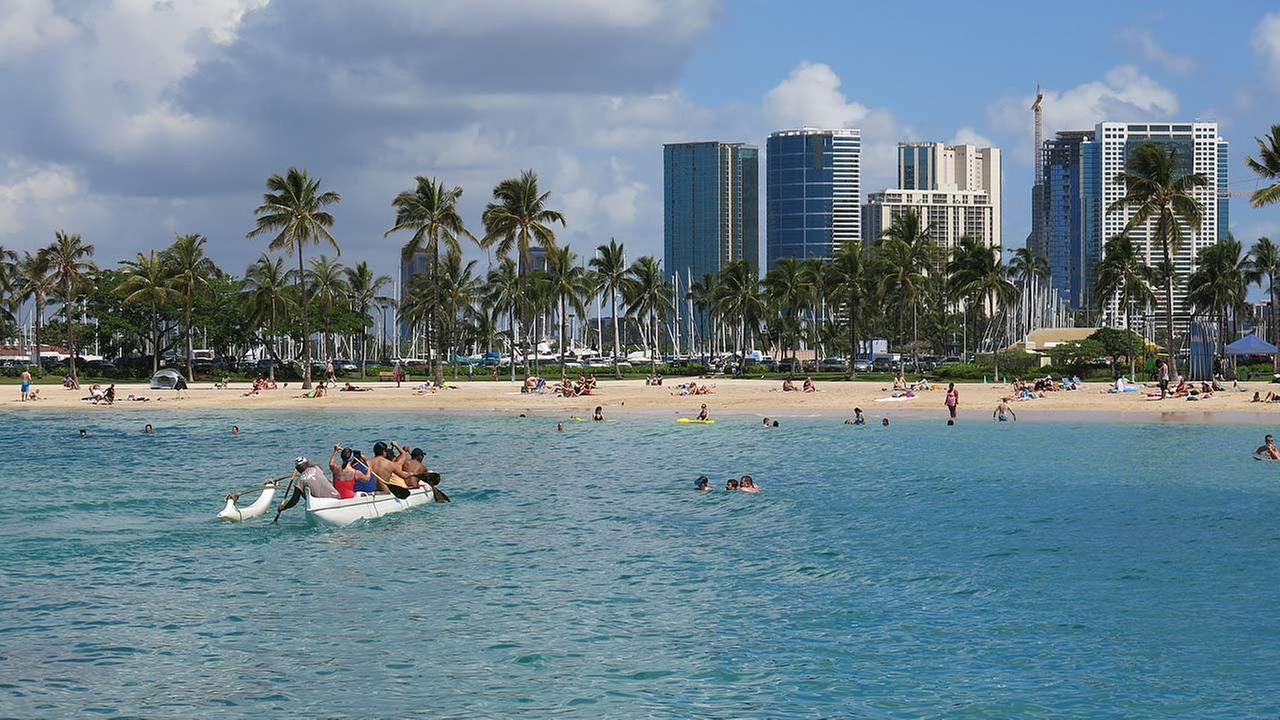 This May 21, 2014 photo shows Duke Kahanamoku Beach in the Honolulu tourist neighborhood of Waikiki in Hawaii.