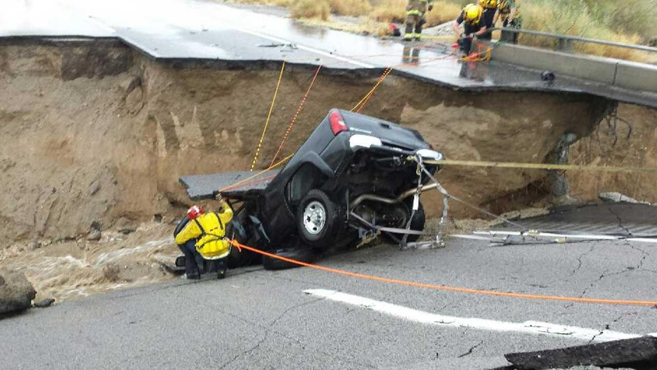 Emergency crews respond after a pickup truck crashed into the collapse of an elevated section of  I-10 in southeastern California
