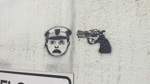 Disturbing graffiti with gun and officer emojis pops up around Houston