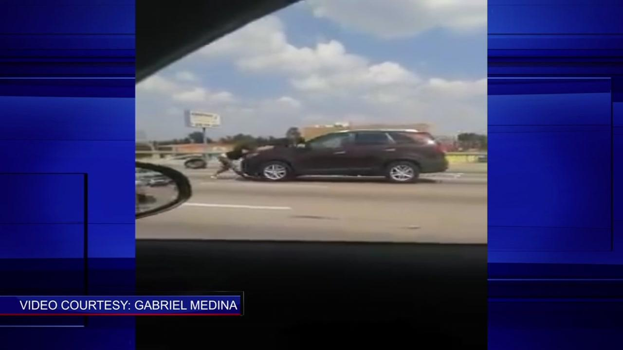 Driver, pedestrian fight caught on camera on Gulf Freeway