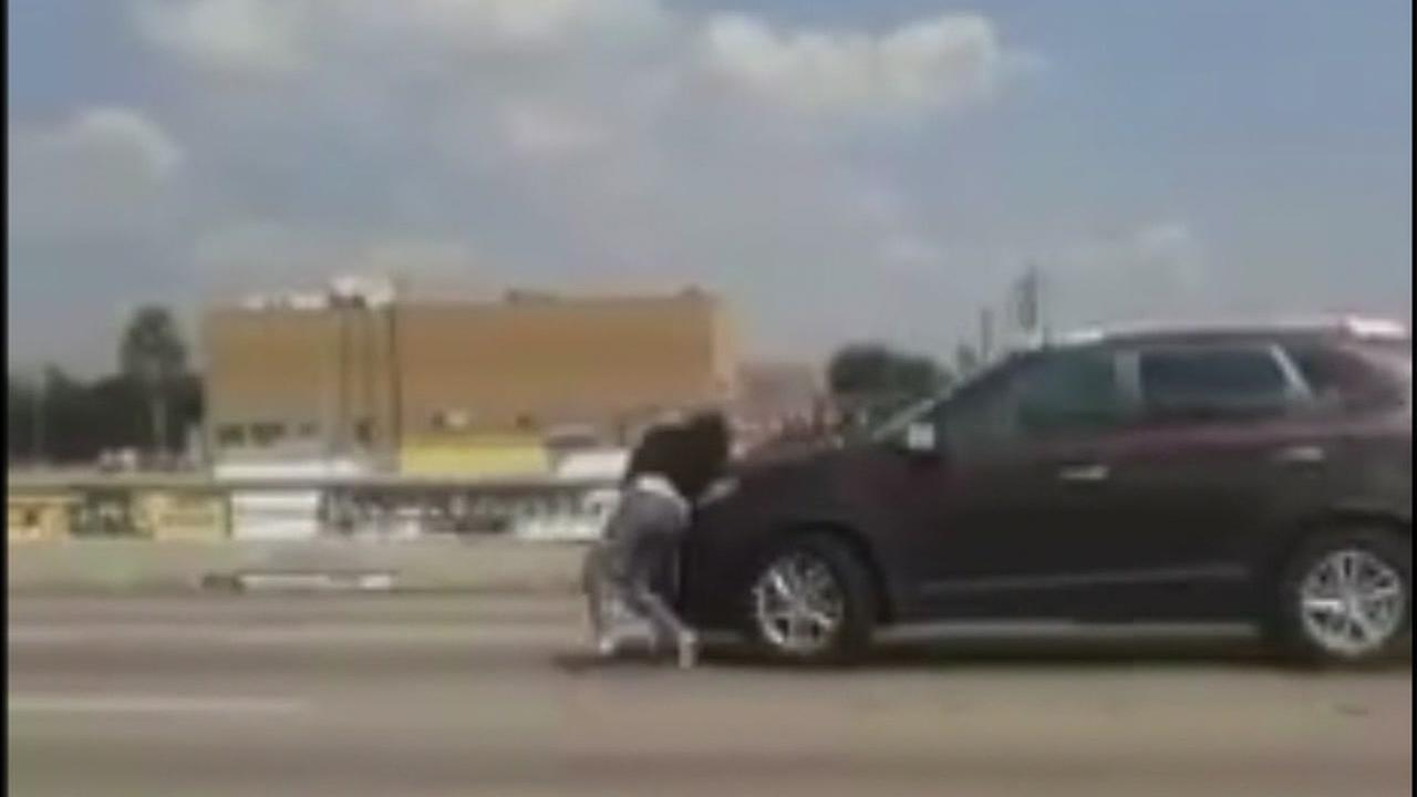 Man charged after freeway fight with pregnant ex