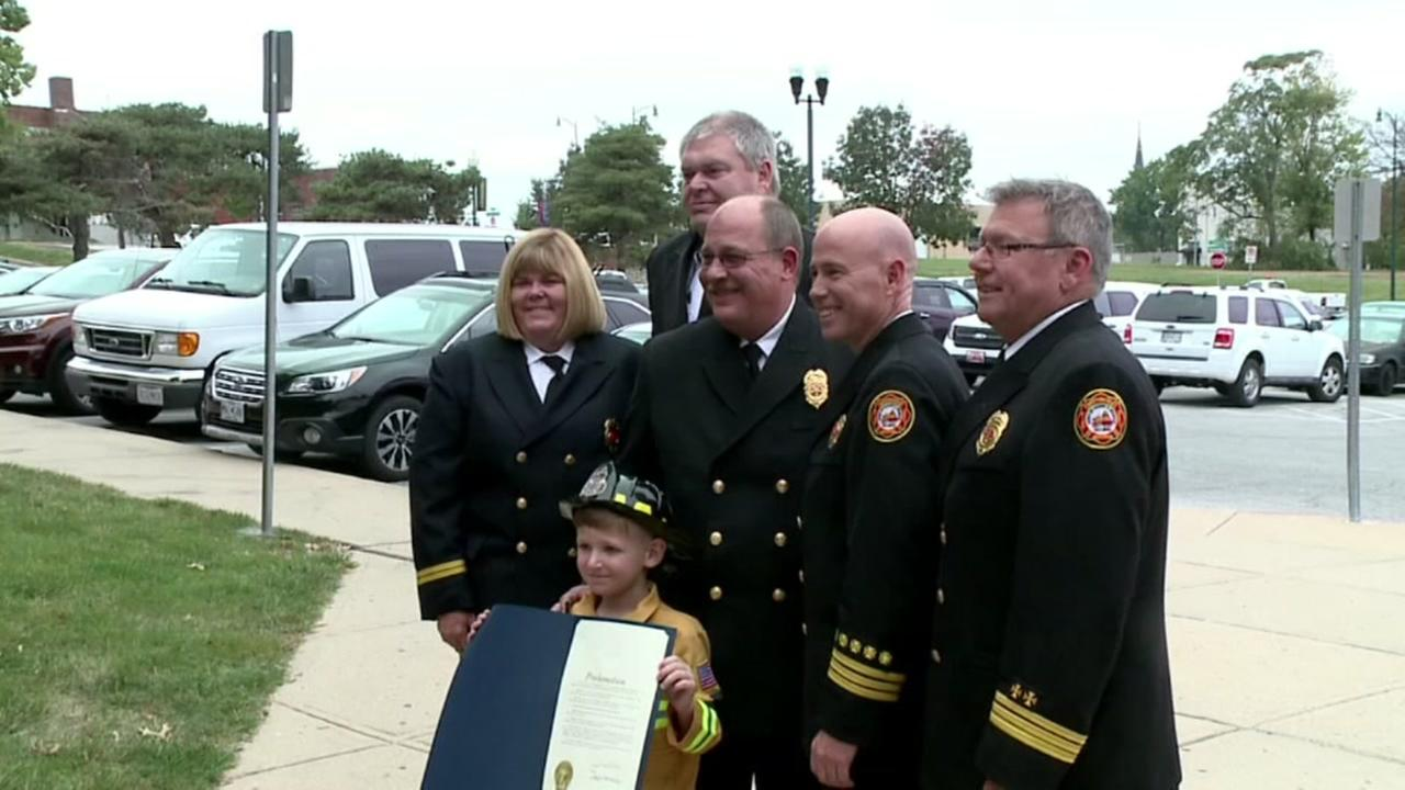 Boy becomes honary firefighter