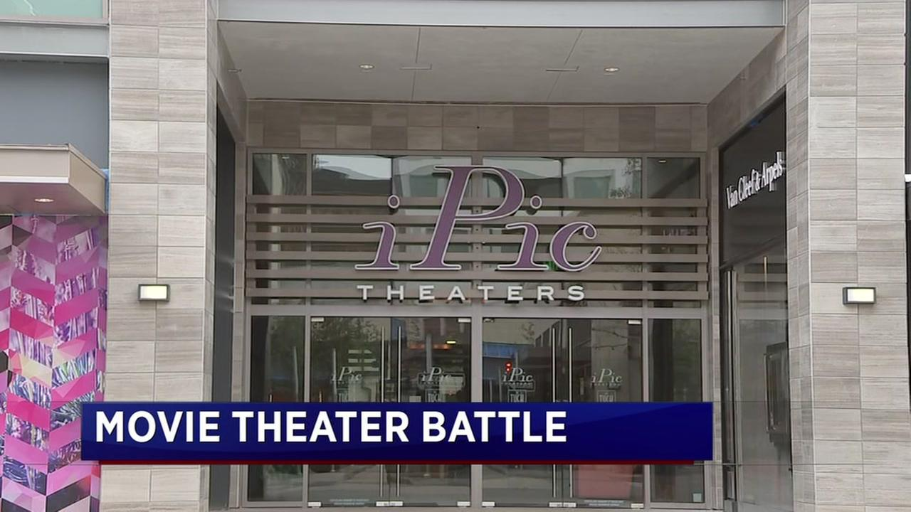 Movie theater battle rages