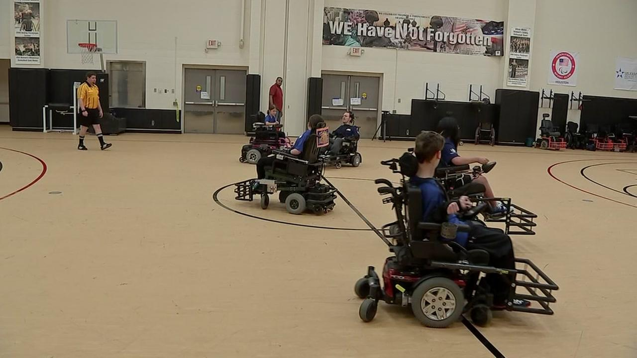 Kids in wheelchair enjoy game of soccer