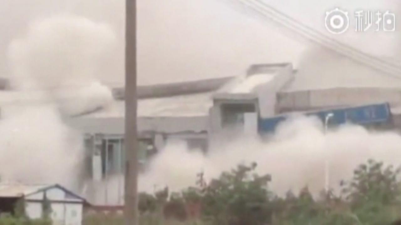 Building collapses after landslide